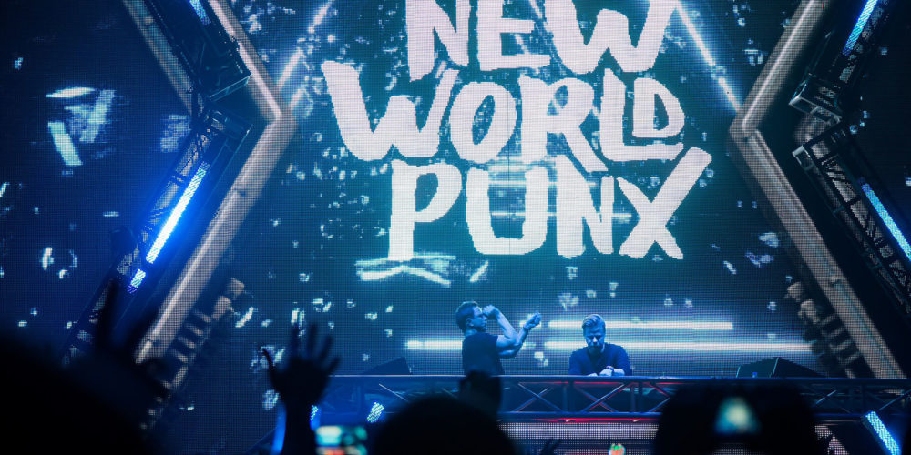 New World Punx logo on screen during concert